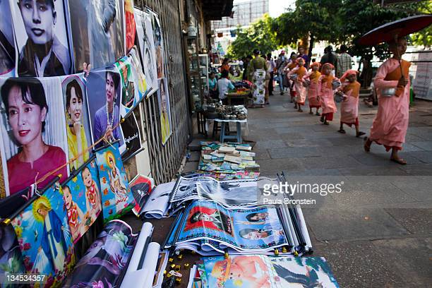 Posters of human rights activist and politician Aung San Suu Kyi and her father Aung San are sold by street vendors on December 2 2011 in Yangon...