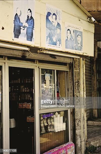 Posters of Iraqi President Saddam Hussein and King Hussein bin Talal of Jordan Amman Jordan 1991
