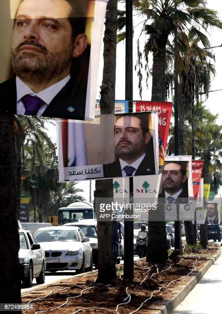 Posters of Lebanese Prime Minister Saad Hariri who resigned last week in a televised speech airing from the Saudi capital Riyadh hang on Beirut's...