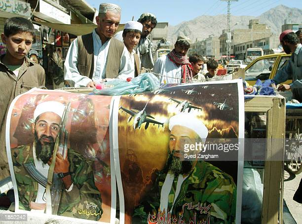 Posters of Osama Bin Laden are displayed at a road side book market March 16 2003 in Quetta Pakistan US and Pakistani forces have intensified their...
