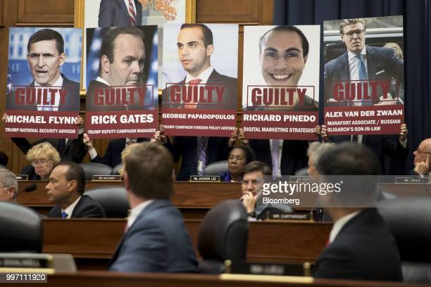 Posters of people who have plead guilty in special counsel Robert Mueller's probe into Russian interference in the US elections are held by staff...