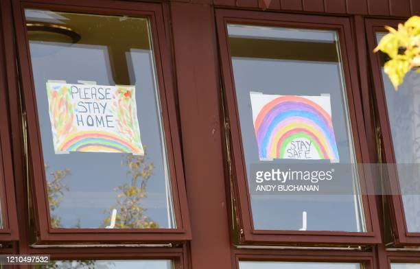 Posters of rainbows, being used as a symbol of hope during hte novel coronavirus pandemic, are pictured in the windows of Castle View Care Home,...