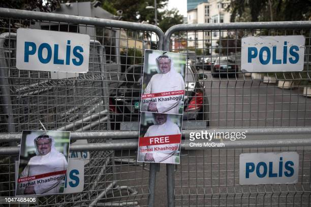 Posters of Saudi journalist Jamal Khashoggi are seen stuck to a police barricade in front of Saudi Arabia's consulate on October 8 2018 in Istanbul...