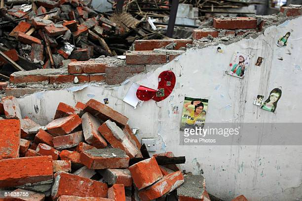 Posters of stars are seen on a earthquake-damaged wall at the Yinghua Township on June 19, 2008 in Shifang of Sichuan Province, China. More than...
