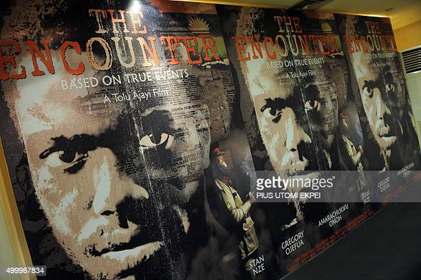 Posters of The Encounter are displayed during a presentation in Lagos on December 4 2015 The Ecounter is a fictional story which focuses on Odumegwu...
