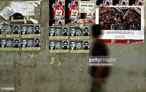Posters of wanted Jordanian Islamist Abu Musab alZarqawi are plastered along side election posters that read On the 30th of January the heroes of...