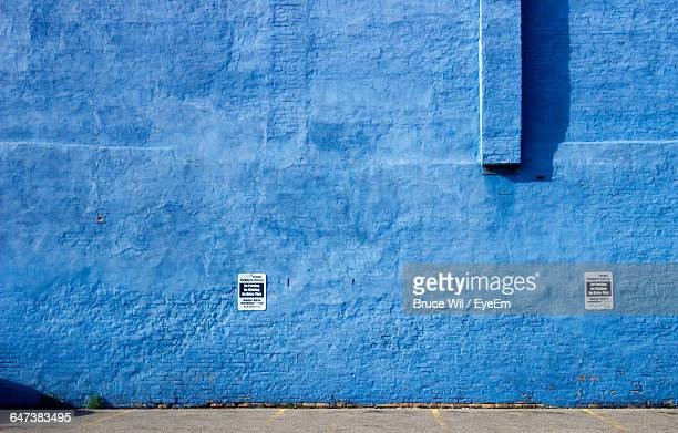 Posters On Blue Wall