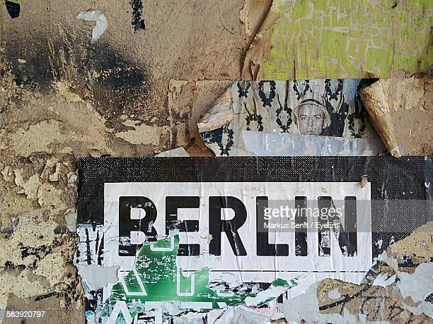 posters on old wall - berlin stock pictures, royalty-free photos & images