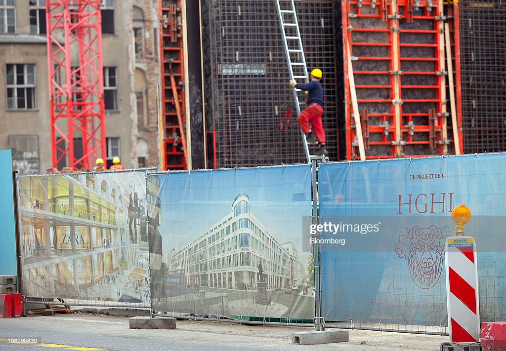 Posters on protective hoardings for the Leipziger Platz shopping mall, Berlin's largest commercial project by developer High Gain House Investments GmbH (HGHI), are seen alongside the construction site in Berlin, Germany, on Wednesday, May 8, 2013. Germany, Europe's largest economy, reported growth in the construction industry during April, according to Markit Economics. Photographer: Krisztian Bocsi/Bloomberg via Getty Images