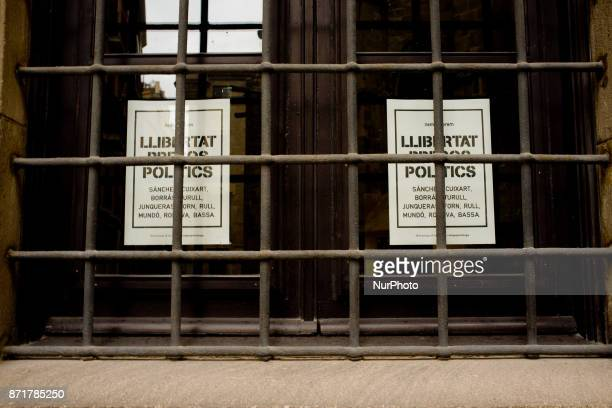 Posters reading 'freedom for political prisoners' hang outside a window of the Catalan Exterior Affairs office whose head Raul Romeva was deposed of...