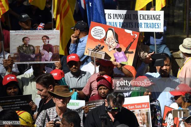 Posters referring to Myanmar's State Counsellor Aung San Suu Kyi are displayed at a protest during the ASEAN Australia Special Summit in Sydney on...