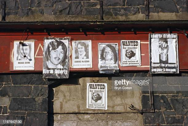 Posters supporting Bobby Sands and other Irish Republican Army terrorists during their 1980 hunger strike sit alongside a wanted poster for British...