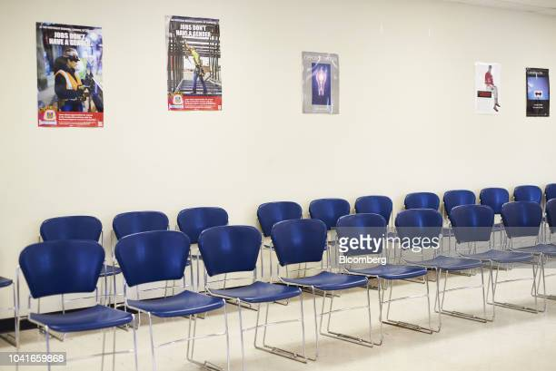 Posters that read Jobs Don't Have A Gender hang on display during a job recruitment event for Banker Steel Co in New Brunswick New Jersey US on...