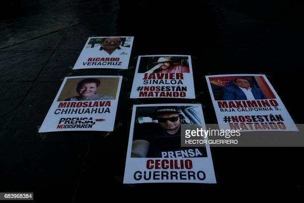Posters with photos of Mexican journalists killed in 2017 are placed during a protest against the recent murder of the of Mexican journalist Javier...