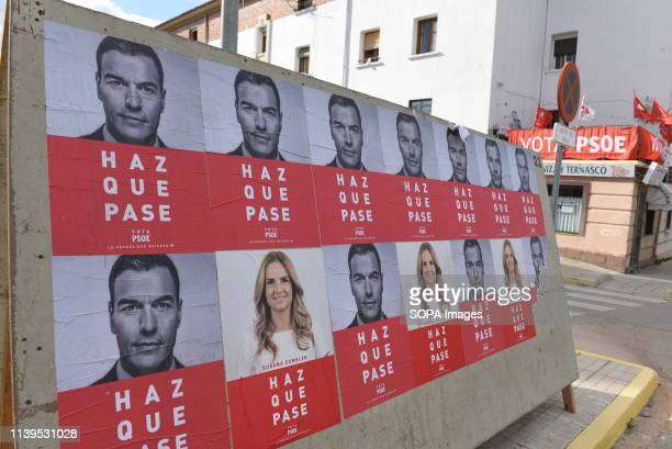 Posters with pictures depicting Spain's Prime Minister and Socialist Party leader Pedro Sanchez and Susana Sumelzo are seen in Calatayud Voters in...