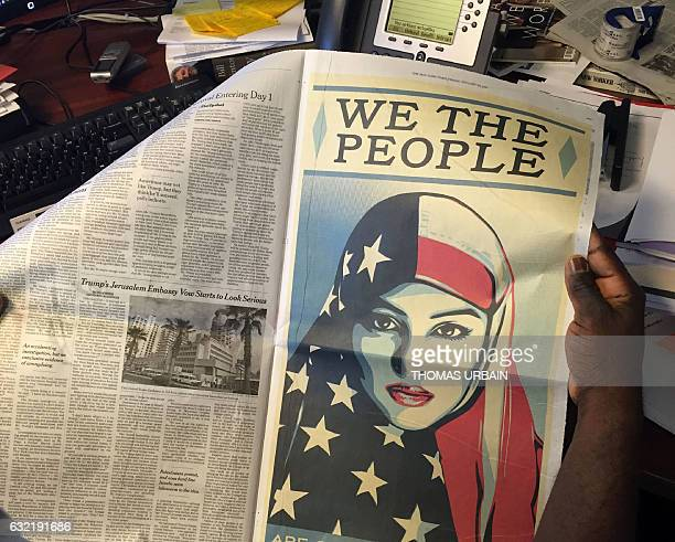 A postersize image of a woman in a headscarf in the colors of the American flag is viewed as it appeared in a fullpage ad in several US newspapers on...