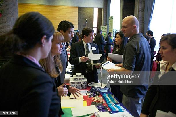 A postgraduate student at Rutgers University speaks with a representative from AIG a financial services and insurance company during a job fair at...