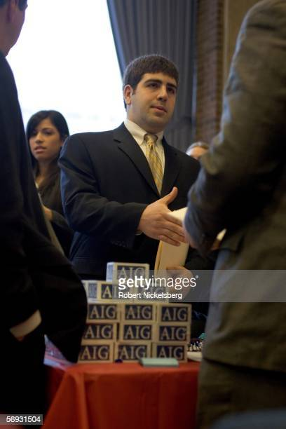 A postgraduate student speaks with a representative from AIG a financial services company during a job fair at Rutgers University on January 4 2006...
