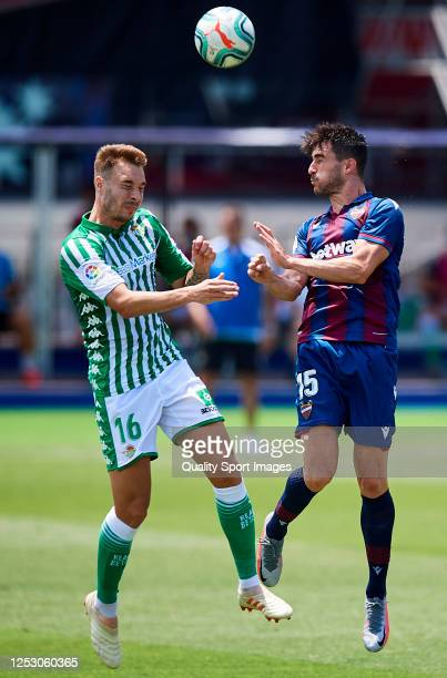 Postigo of Levante UD competes for the ball with Loren Moron of Real Betis Balompie during the Liga match between Levante UD and Real Betis Balompie...