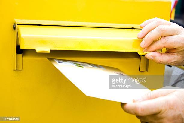posting letter at mailbox - inserting stock pictures, royalty-free photos & images