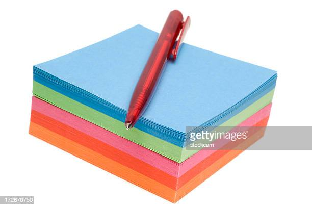Post-it note and pen isolated on white