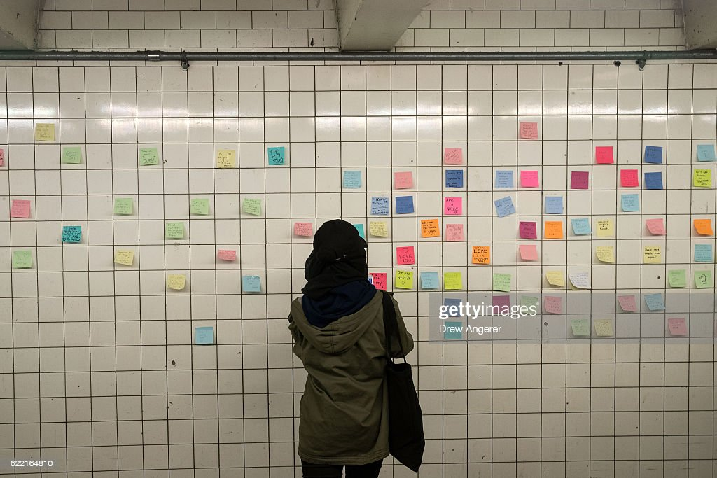 Post-it notes, many with politically themed messages, hang on a wall at the 6th Avenue subway station as part of a public art project entitled 'Subway Therapy,' November 10, 2016 in New York City. Artist Matthew Chavez, who goes by 'Levee,' created the 'Subway Therapy' wall to offer New Yorkers a chance to write down their feelings in the wake of the presidential election.
