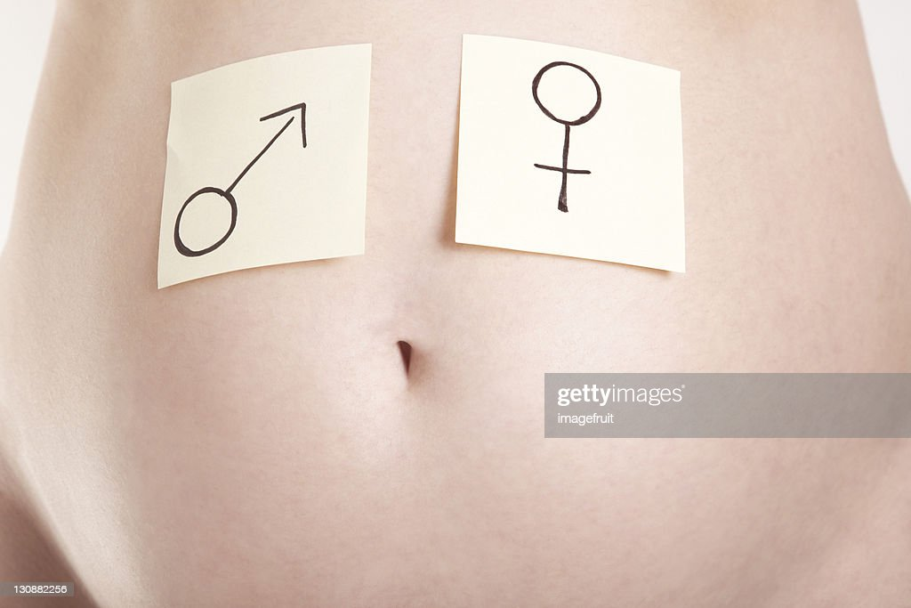 Postit Notes With Male And Female Symbols On A Pregnant Belly Stock