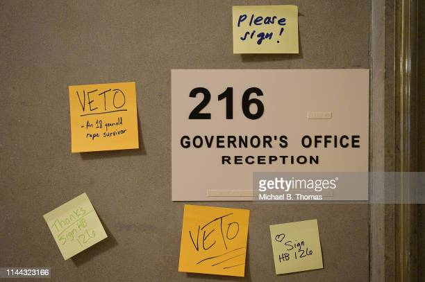 Postit notes with messages calling for signing and veto are seen outside Missouri Gov Mike Parson's office on May 17 2019 in Jefferson City Missouri...