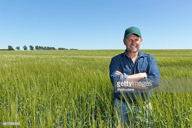 Postive Farmer at his Farm in a Wheat Field
