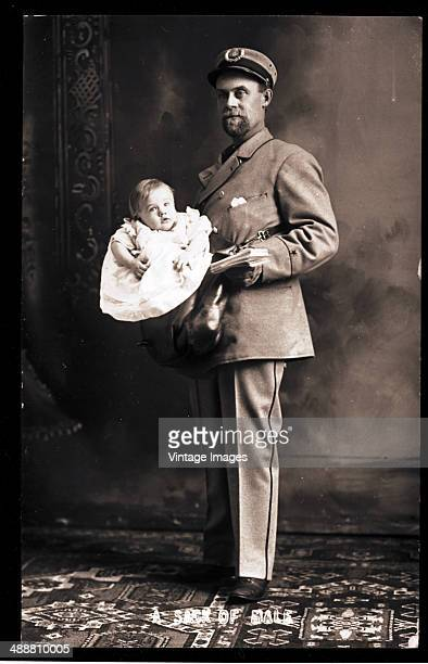A US postman carrying a baby boy along with his letters USA circa 1890