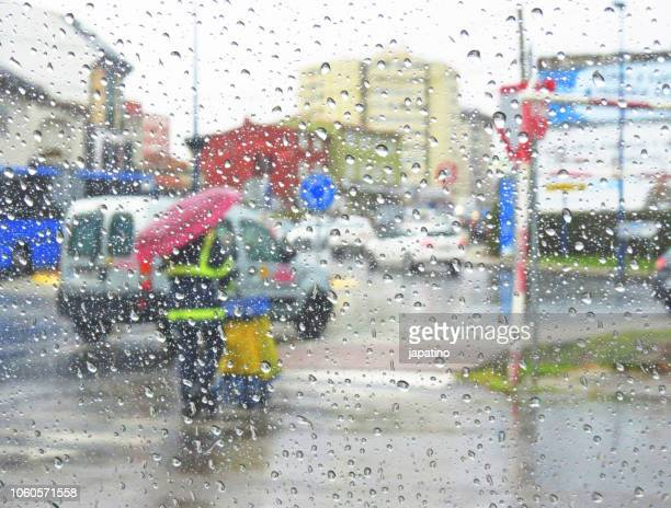 postman delivering mail in the rain - torrential rain stock pictures, royalty-free photos & images