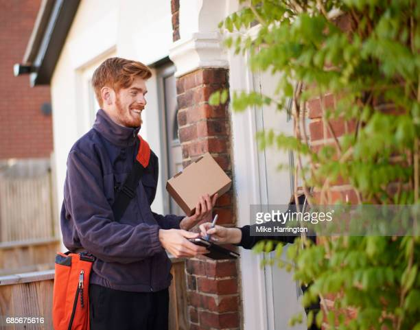 Postman delivering package to resident