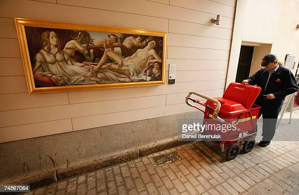 A postman delivers mail near a reproduction of Sandro Botticelli's Venus and Mars on June 12 2007 in London England The Grand Tour is an exhibition...