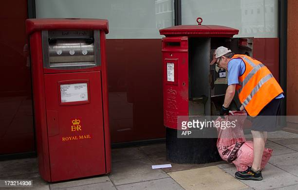 A postman empties a Royal Mail post box in London on July 10 2013 Britain's government announced plans to privatise more than half of Royal Mail the...