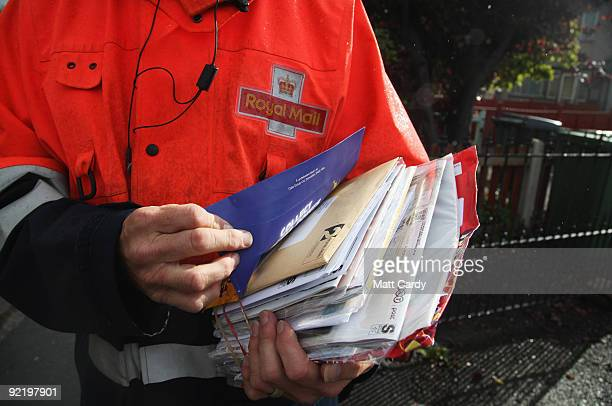 Postman Gerry Cryer delivers the post on October 23 2009 in Bristol England Although some postal workers were on strike today domestic deliveries...