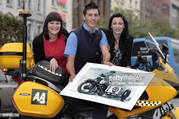 Postman Keith Lally and AA Roadwatch presenters Elaine O'Sullivan Louise Duffy outside the GPO in Dublin at the unveiling of the new 55c stamp...
