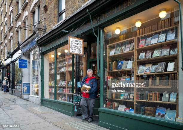 postman leaving a book shop in charing cross road, london - book store stock photos and pictures