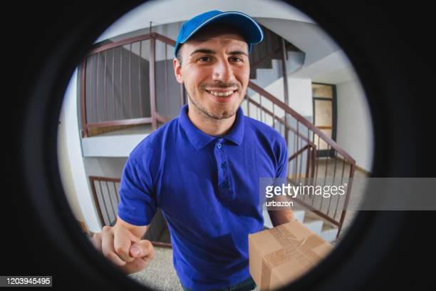 postman with package at the door - ringing doorbell stock pictures, royalty-free photos & images