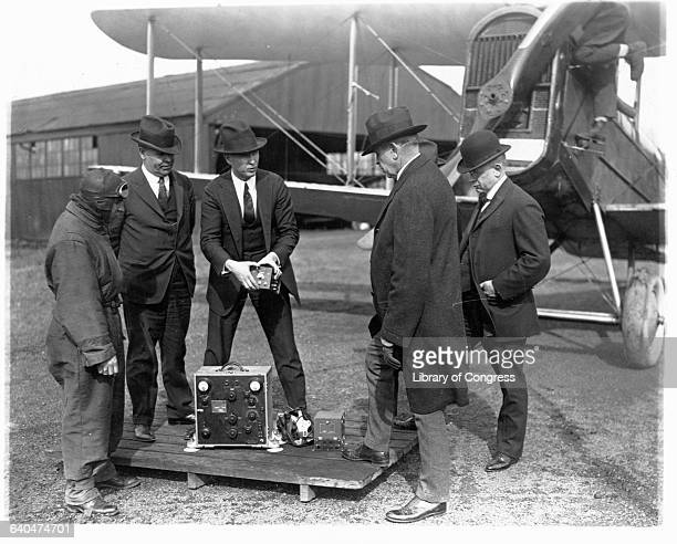 Postmaster General Work and his assistants check the new radio equipment to be installed in airmail planes