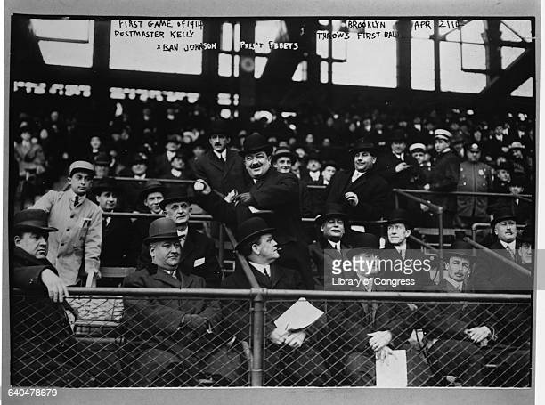 Postmaster Kelly prepares to throw out the first pitch on opening day at Ebbets Field Ban Johnson founder of the National League and Charlie Ebbets...