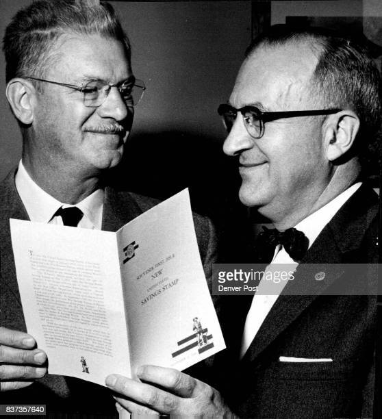 Postmaster Ted G Hefner makes the first sale in Denver of the new 25cent red white and blue U S saving stamp to Gerald Peters Denver County chairman...