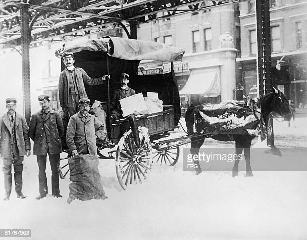 Postmen taking a break from delivering Christmas mail USA circa 1925