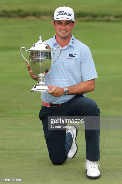 Poston celebrates with the trophy after winning the Wyndham Championship at Sedgefield Country Club on August 04, 2019 in Greensboro, North Carolina.