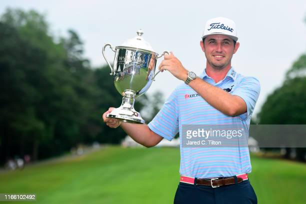 T Poston celebrates with the trophy after winning the Wyndham Championship at Sedgefield Country Club on August 04 2019 in Greensboro North Carolina