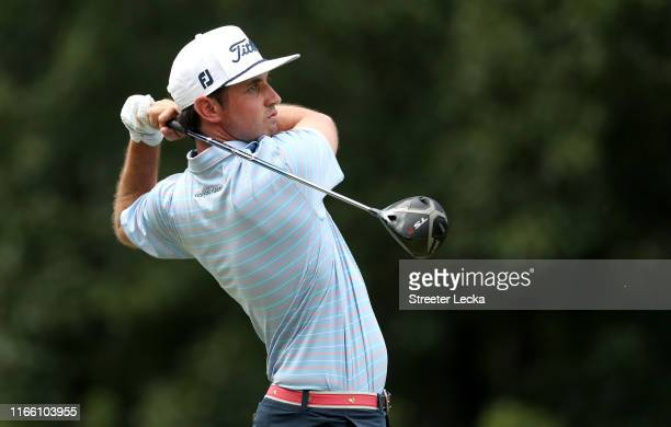 Poston hits a tee shot on the fifth hole during the final round of the Wyndham Championship at Sedgefield Country Club on August 04, 2019 in...