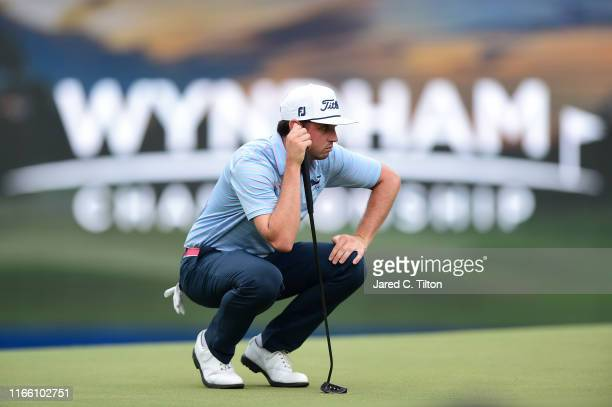 Poston lines up a putt on the 18th green during the final round of the Wyndham Championship at Sedgefield Country Club on August 04, 2019 in...