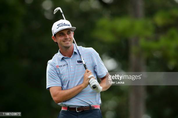 Poston reacts following his tee shot on the 16th hole during the final round of the Wyndham Championship at Sedgefield Country Club on August 04,...