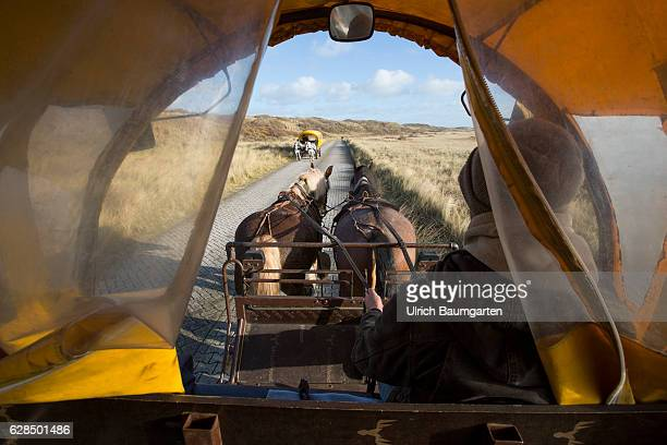 Post-season on the North Sea Island of Juist. Horse taxis for the transportation of people and material on the island.