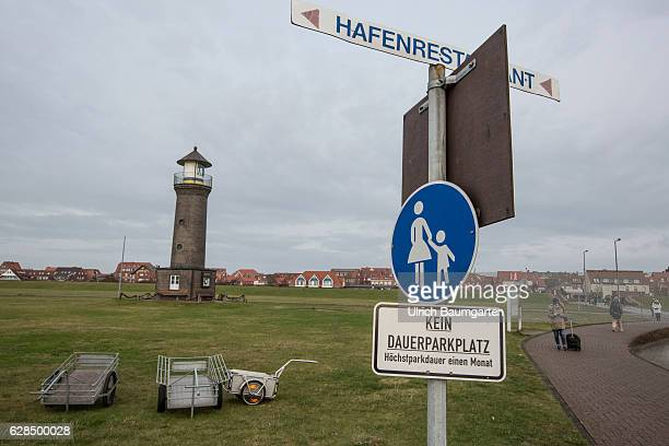 Post-season on the North Sea Island of Juist. Note! No permanent parking, maximum one-month parking! In the backgroung transport carts and a...