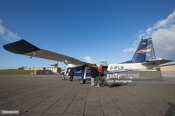 Postseason on the North Sea Island of Juist Propeller aircraft of the company Frisia on the airfield of Juist